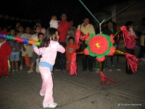 hitting a piata - How Is Christmas Celebrated In Mexico
