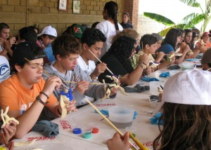 A student group paints alebrijes
